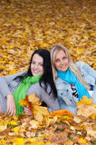 Two happy  women in autumn forest Stock Photos