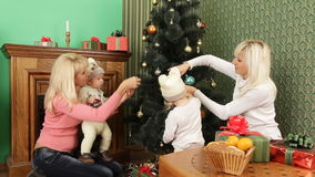 Two Happy Women With Babies Decorating Christmas stock footage