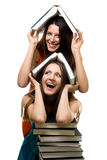 Two happy women with books together Royalty Free Stock Photography