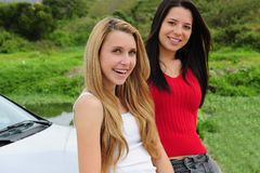 Two happy women on car trip. Two happy women on road-trip by car stock images