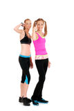 Two happy women doing zumba Fitness. Flexing their arms Royalty Free Stock Image