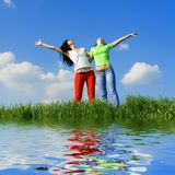 Two happy women dreams to fly Stock Images
