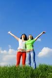 Two happy women dreams to fly on winds Stock Photos
