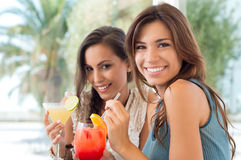 Two Happy Women Drinking Juice Royalty Free Stock Images