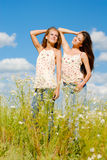 Two happy women enjoying sun outdoors Royalty Free Stock Photography