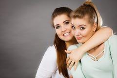 Two happy women friends having fun Stock Photos