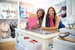 Two happy women friends shopping for lingerie Royalty Free Stock Images