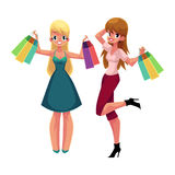 Two happy women, girls, friends with shopping bags, holiday sale Royalty Free Stock Image
