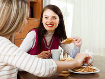 Two happy  women gossiping  in home Stock Images