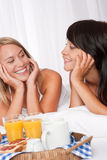 Two happy women having breakfast Stock Photo