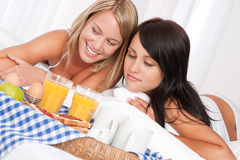 Two happy women having home made breakfast Stock Photos