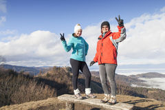 Two happy women hikers showing Victory sign Royalty Free Stock Photos