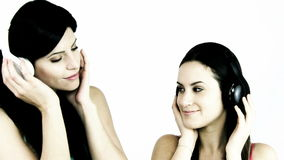 Two happy women listening music. Beautiful women listening soft music stock video footage