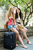 Two happy women with luggage Royalty Free Stock Photos