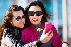 Two happy women making selfie photo Stock Image