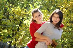 Two happy women on natural background Royalty Free Stock Photography