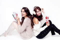 Two happy women opening christmas presents Stock Image