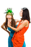 Two happy women play in venetian maquarade masks Stock Images