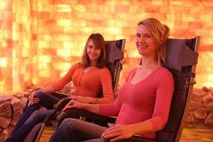 Two happy women relaxing in holotherapy salt room Stock Photo