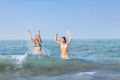 Two happy women in sea Stock Photos