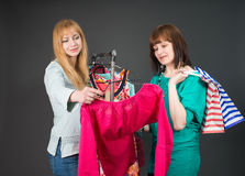 Two happy women shopping in clothes store. Stock Photography