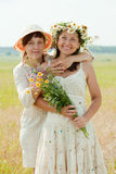 Two happy women   in summer field Stock Images