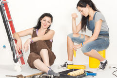 Two happy women taking a break from decorating Royalty Free Stock Photography
