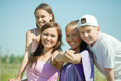 Two happy  women with teens Royalty Free Stock Image