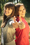 Two happy women with thumbs up Royalty Free Stock Photo