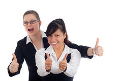 Two happy women thumbs up Stock Image