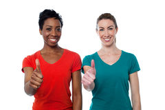 Two happy women with thumbs up Royalty Free Stock Photos