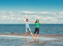 Two happy women in the water of sea Stock Images
