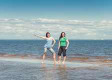Two happy women in the water of sea Royalty Free Stock Photo
