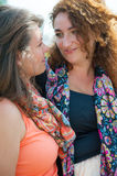 Two happy young beautiful women Stock Images