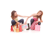 Two happy young beautiful women with the purchases Royalty Free Stock Images