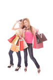 Two happy young beautiful women with the purchases Stock Images