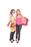 Two happy young beautiful women with the purchases Stock Photos