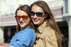 Two happy young beautiful women in sunglasses Royalty Free Stock Image
