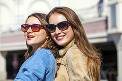 Two happy young beautiful women in sunglasses Stock Photo