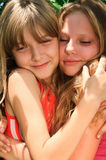 Two happy young blond girls Stock Image