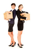 Two happy young business women with carton boxes, standing and s Royalty Free Stock Photos