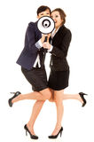 Two happy young business women with megephone Royalty Free Stock Photo
