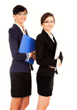 Two happy young business women standing and smiling Stock Image