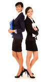 Two happy young business women standing and smiling Stock Photo