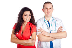 Two happy young doctors. Happy couple of handsome men doctor and pretty nurse in blue, white and tangerine tango uniforms, looking at camera. Full body image Stock Images