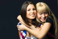 Two happy young embracing friends Stock Image