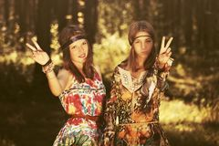 Two happy young fashion girls walking in summer forest Royalty Free Stock Photos