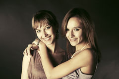 Two happy young fashion women Royalty Free Stock Images