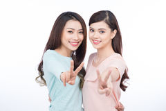 Two happy young female friends. Asian girls laughing. Two happy young female friends. Asian girls laughing Stock Photo