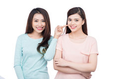 Two happy young female friends. Asian girls laughing. Two happy young female friends. Asian girls laughing royalty free stock photos